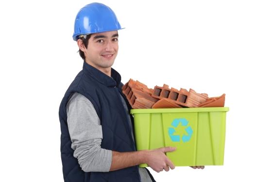 Workman hauling junk